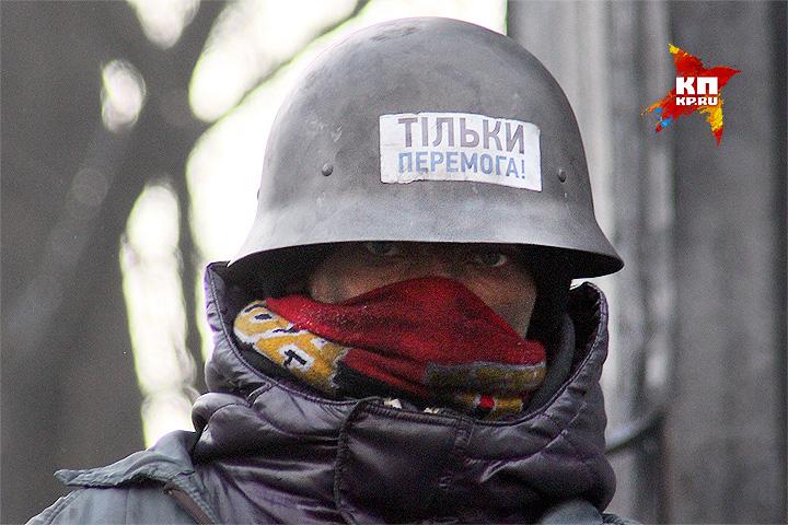 "Один из бойцов ""майдана"" в феврале 2014 года. Фото: Александр КОЦ, Дмитрий СТЕШИН"