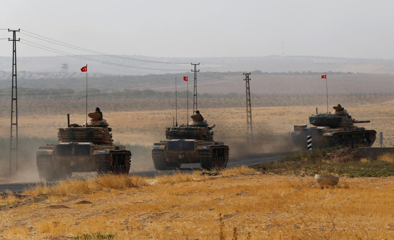Турецкие войска начали спецоперацию в Сирии, переехав на танках через границу. Фото: REUTERS