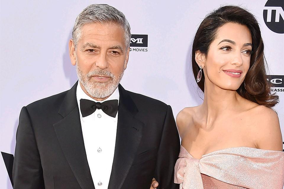 Актер Джордж Клуни с супругой Амаль.