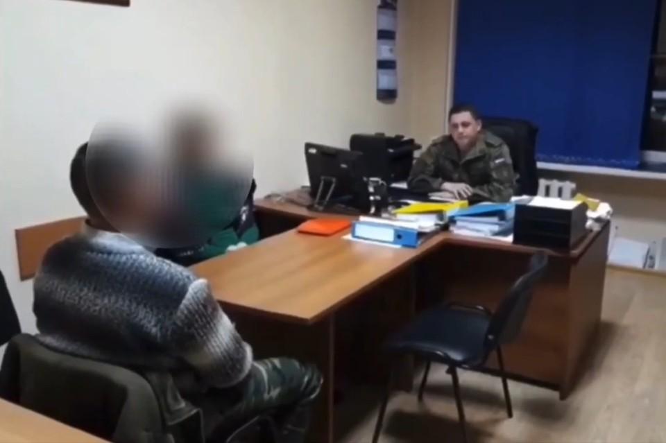 Подозреваемый во время допроса. Фото: СК России.
