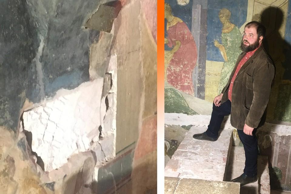 Хранитель Успенского собора Алексей Барков показывает нижнюю часть фрески.