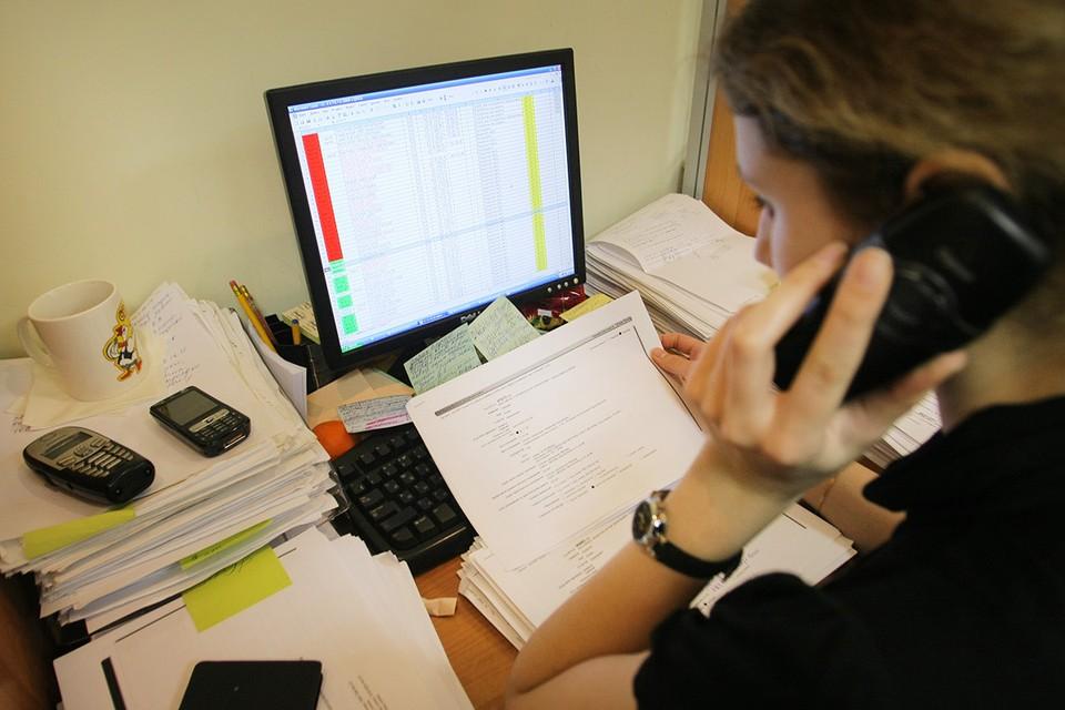 Сотрудник коллекторского агентства во время работы. Фото: ИТАР-ТАСС/ Виталий Белоусов