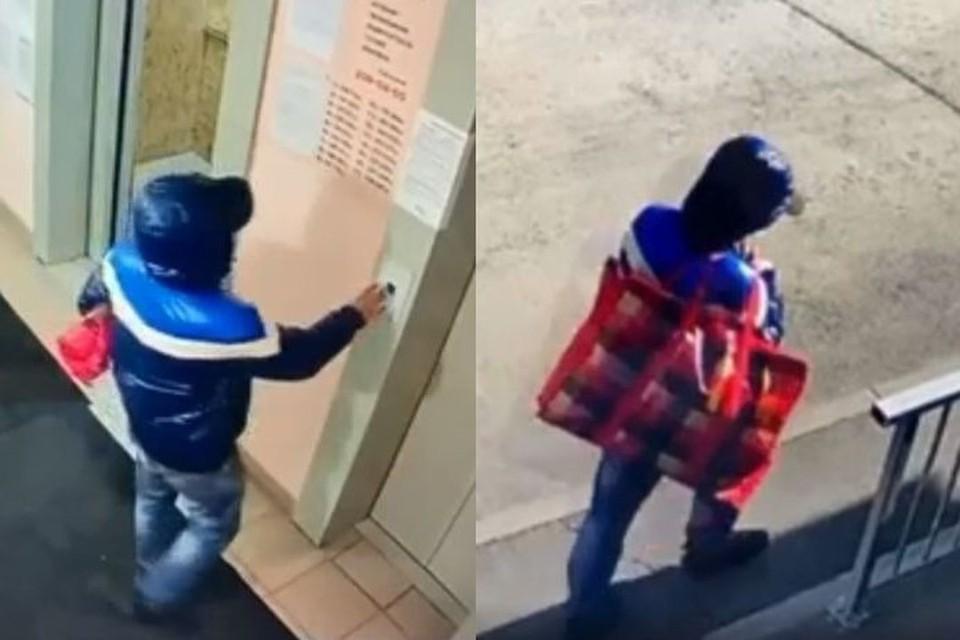В Новосибирске двое мужчин украли пожарные рукава из подъезда жилого дома. Фото: Кадр из видео