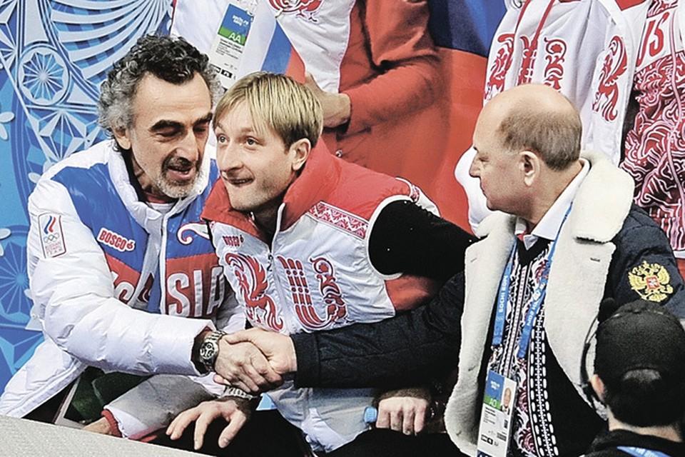 Олимпийские эмоции: хореограф Давид Авдыш (слева) и тренер Алексей Мишин (справа) поздравляют друг друга после выступления Евгения Плющенко.
