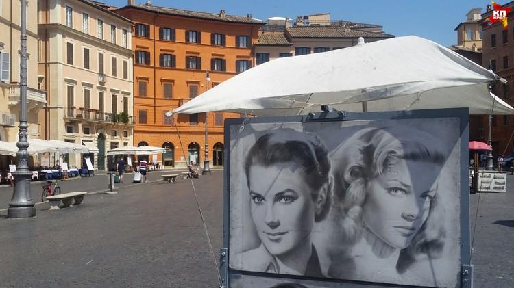 На Piazza Navona всегда играют уличные музыканты, а художники продают свои работы.