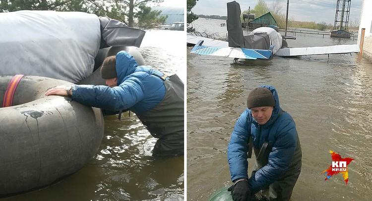 Попытка спасти технику при помощи надувных плотов. ФОТО Виталий КОРОЛЕВ