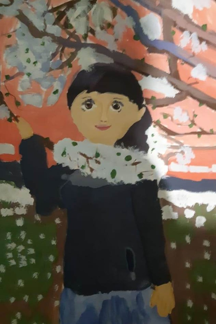 Оля нарисовала портрет мамы. Фото: Кира Лысенко.