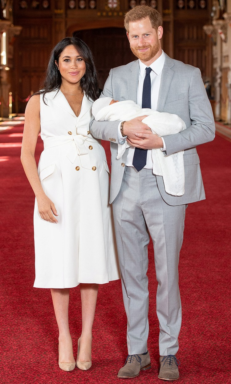 Принц Гарри и Меган Маркл c малышом.
