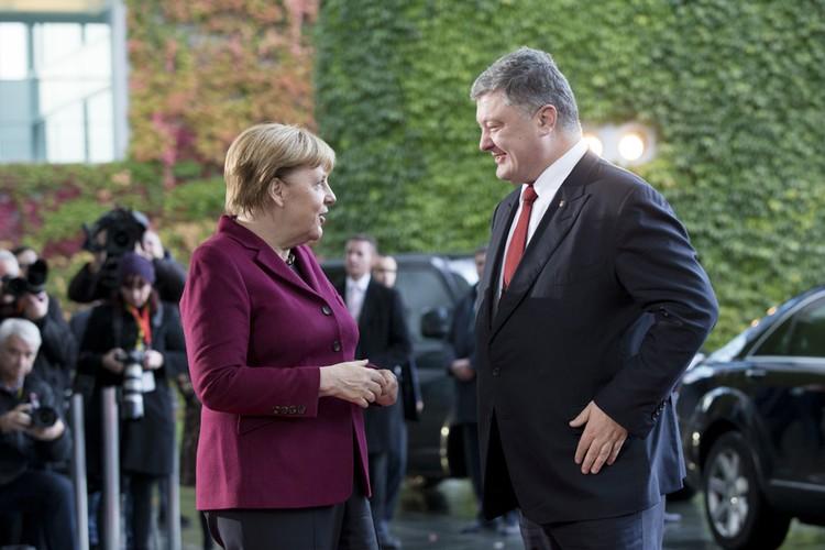 Меркель стала инициатором встречи Путина и Порошенко.