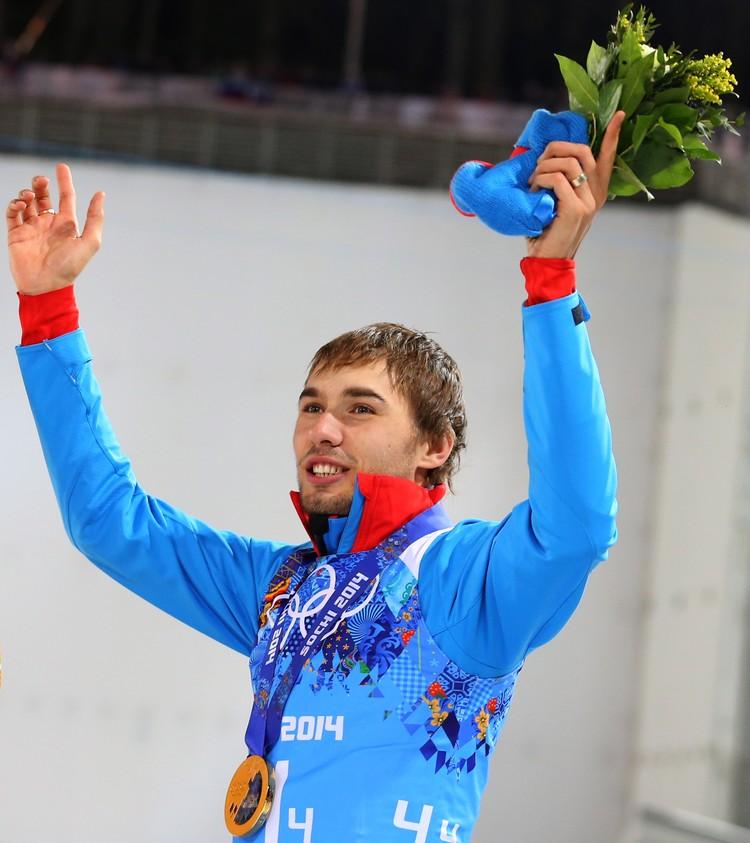 Антон Шипулин, завоевавший золотую медаль в эстафете 4x7,5 км в соревнованиях по биатлону среди мужчин на XXII зимних Олимпийских играх в Сочи. Фото ИТАР-ТАСС/ Валерий Шарифулин